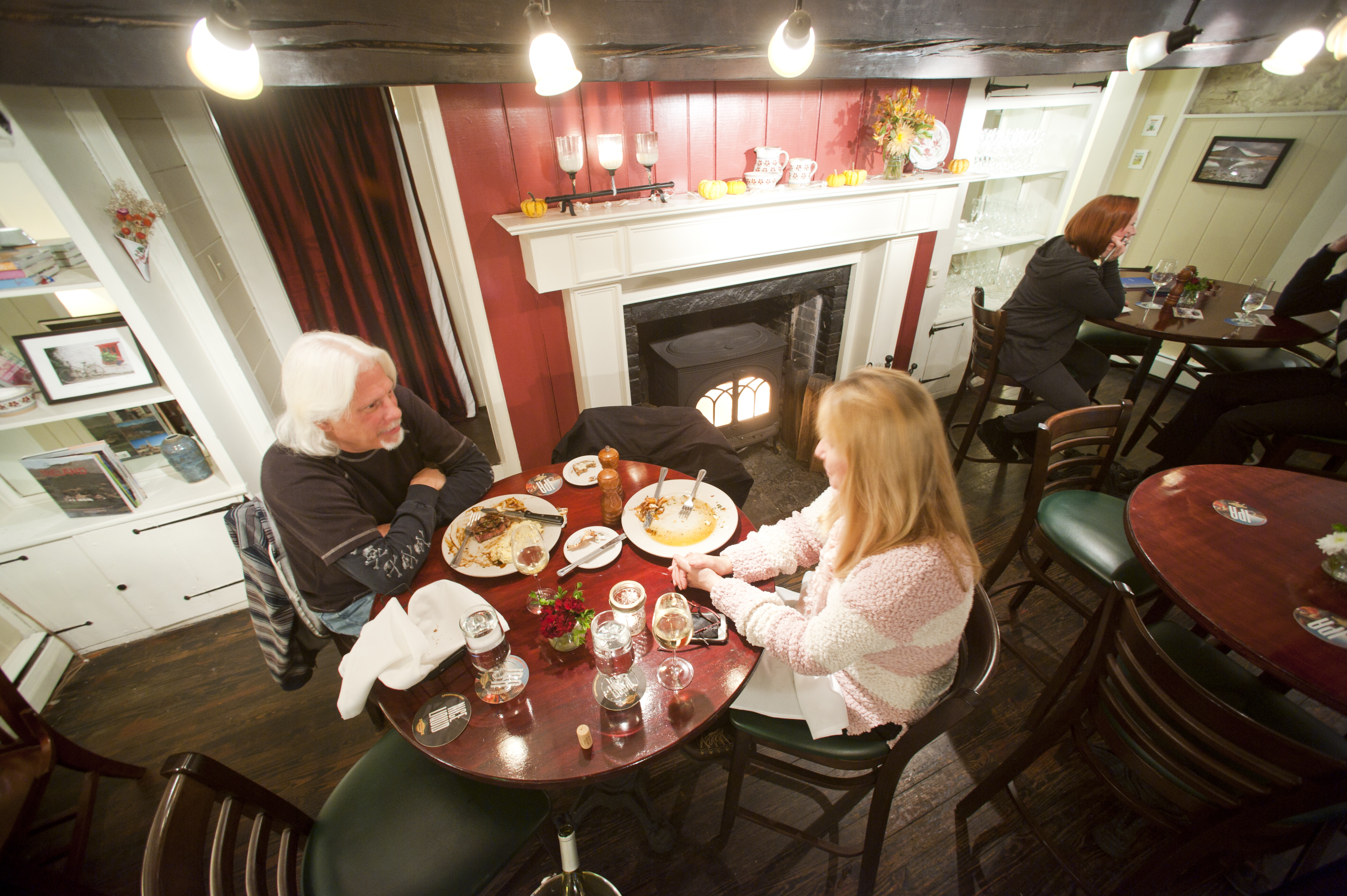 Dean and Daisy Read of New Paltz have dinner near the fire at Garvan's Gastropub in late October. Photo by Karl Rabe.